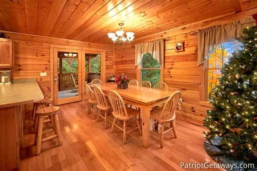 dining table for eight at black bear lodge a 5 bedroom cabin rental located in pigeon forge