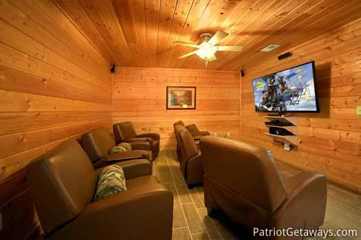 home theater with six seats and large flat screen tv at black bear lodge a 5 bedroom cabin rental located in pigeon forge
