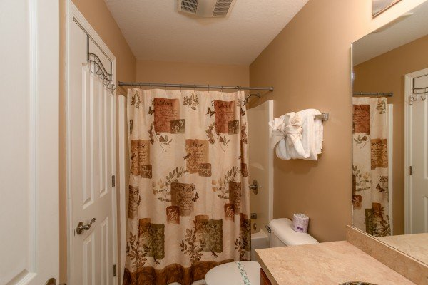 Bathroom with a tub and shower at Autumn Blaze, a 2-bedroom cabin rental located in Pigeon Forge