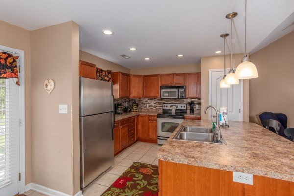 Kitchen with stainless appliances and an island at Autumn Blaze, a 2-bedroom cabin rental located in Pigeon Forge
