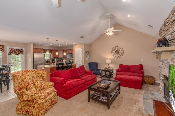 Living room with a couch, loveseat, and chair at Autumn Blaze, a 2-bedroom cabin rental located in Pigeon Forge