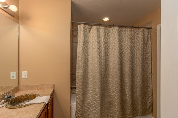 Bathroom with tub and shower at Autumn Blaze, a 2-bedroom cabin rental located in Pigeon Forge