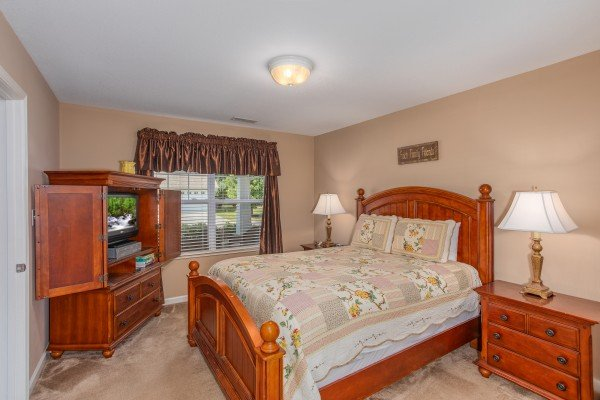 Second bedroom with Armoire at Autumn Blaze, a 2-bedroom cabin rental located in Pigeon Forge