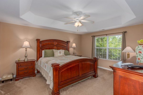Bedroom with a king bed and tray ceiling at Autumn Blaze, a 2-bedroom cabin rental located in Pigeon Forge