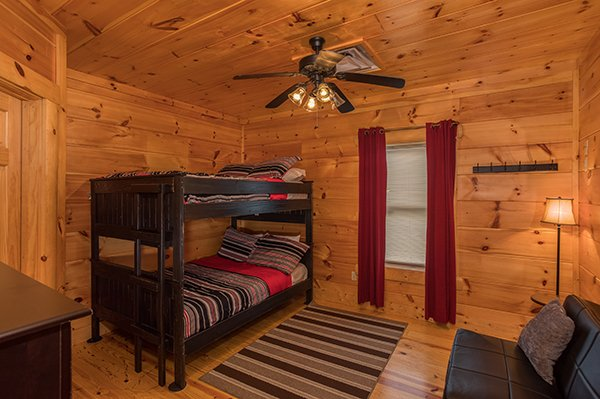 Lower level bedroom with bunks and futon at Pigeon Forge View, a 6 bedroom cabin rental located in Pigeon Forge