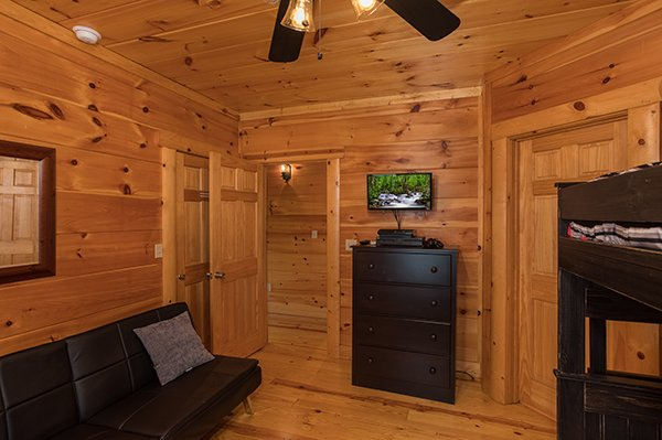 Chest of drawers and a TV in the bunk room at Pigeon Forge View, a 6 bedroom cabin rental located in Pigeon Forge