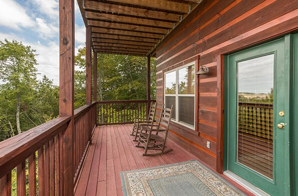 Covered porch with rocking chairs at Pigeon Forge View, a 6 bedroom cabin rental located in Pigeon Forge