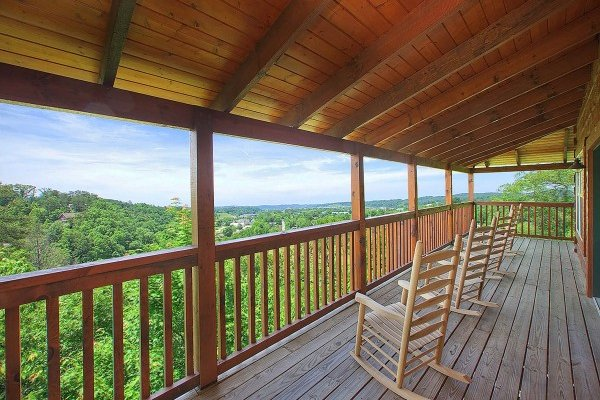 Rocking chairs on a covered deck at Pigeon Forge View, a 6 bedroom cabin rental located in Pigeon Forge