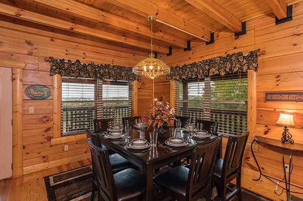 Dining room with seating for eight at Pigeon Forge View, a 6 bedroom cabin rental located in Pigeon Forge