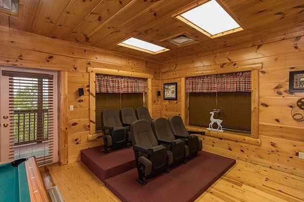 Stadium style seating for the home theater at Pigeon Forge View, a 6 bedroom cabin rental located in Pigeon Forge