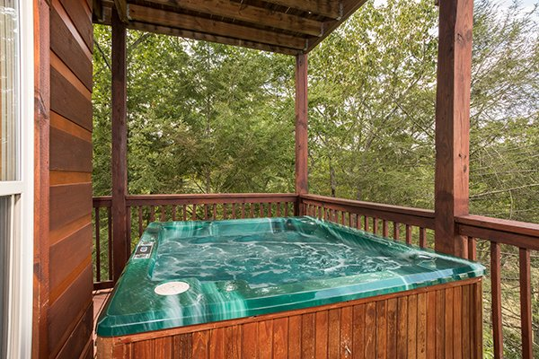 Hot tub on a covered deck at Pigeon Forge View, a 6 bedroom cabin rental located in Pigeon Forge