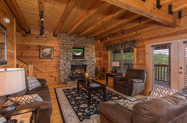 Living room with sofa, loveseat, chair, fireplace, and TV at Pigeon Forge View, a 6 bedroom cabin rental located in Pigeon Forge