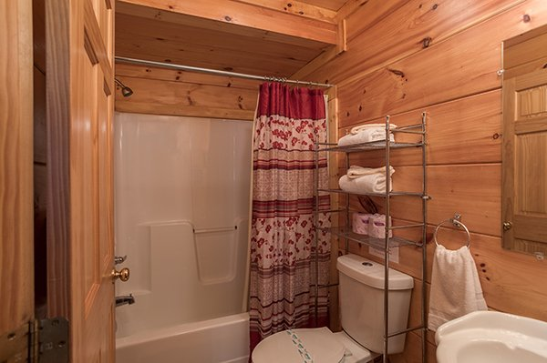 Bathroom with a tub and shower at Pigeon Forge View, a 6 bedroom cabin rental located in Pigeon Forge