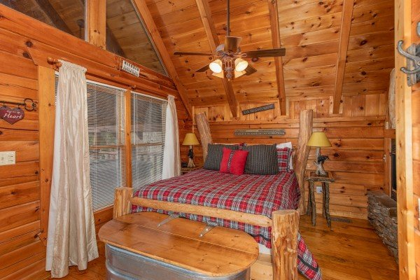 Bedroom with fireplace at Woodland Chalet, a 1 bedroom cabin rental located in Pigeon Forge