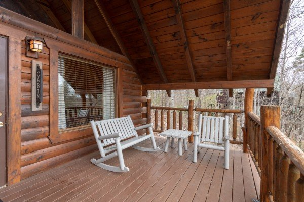 Front porch with rocking chair and bench at Woodland Chalet, a 1 bedroom cabin rental located in Pigeon Forge