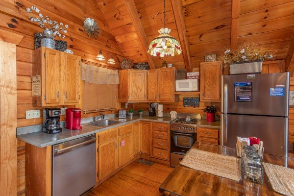 Kitchen with stainless appliances at Woodland Chalet, a 1 bedroom cabin rental located in Pigeon Forge