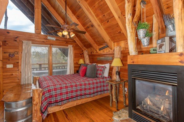 Fireplace in the bedroom at Woodland Chalet, a 1 bedroom cabin rental located in Pigeon Forge