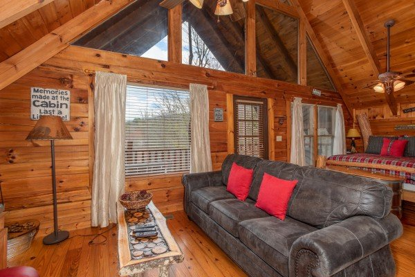 Living room with sofa at Woodland Chalet, a 1 bedroom cabin rental located in Pigeon Forge