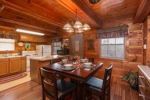 Dining table with seating for four at Beary Good Time, a 1-bedroom cabin rental located in Pigeon Forge