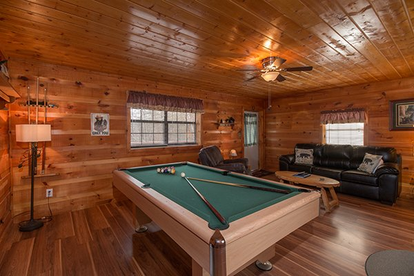 Green felted pool table at Beary Good Time, a 1-bedroom cabin rental located in Pigeon Forge