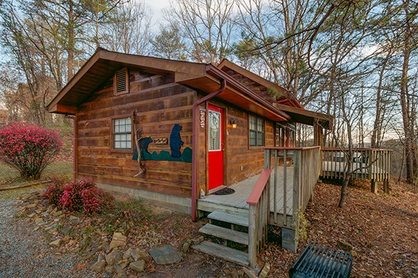 Exterior with custom black bear woodwork at Beary Good Time, a 1-bedroom cabin rental located in Pigeon Forge
