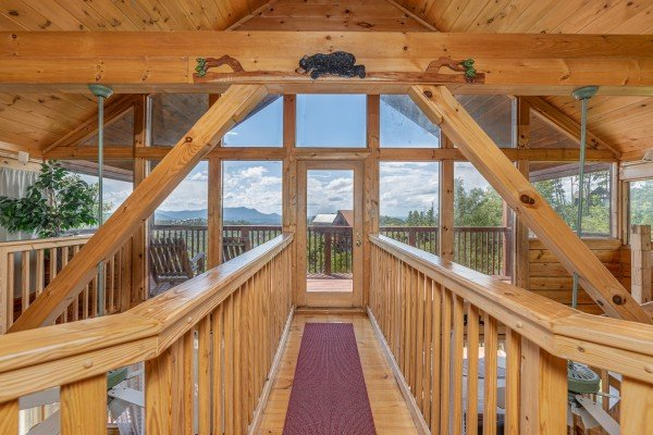 Catwalk to a deck at Smoky Mountain High, a 1 bedroom cabin rental located in Pigeon Forge
