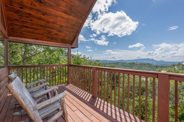 Rocking chairs on a deck with a view at Smoky Mountain High, a 1 bedroom cabin rental located in Pigeon Forge