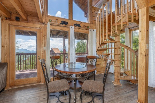 Dining table for four at Smoky Mountain High, a 1 bedroom cabin rental located in Pigeon Forge