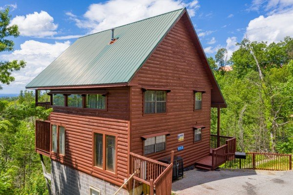 Parking pad and cabin exterior at Smoky Mountain High, a 1 bedroom cabin rental located in Pigeon Forge