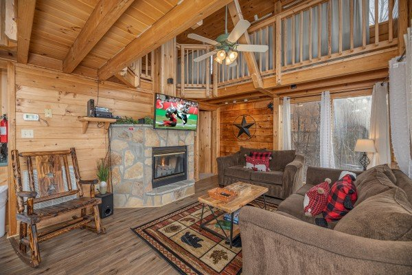 Fireplace and TV at Smoky Mountain High, a 1 bedroom cabin rental located in Pigeon Forge