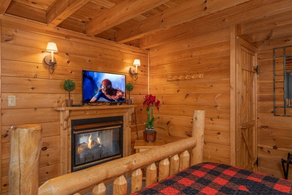 Fireplace and TV in a bedroom at Smoky Mountain High, a 1 bedroom cabin rental located in Pigeon Forge