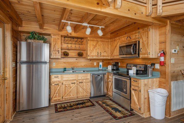 Kitchen with stainless appliances at Smoky Mountain High, a 1 bedroom cabin rental located in Pigeon Forge