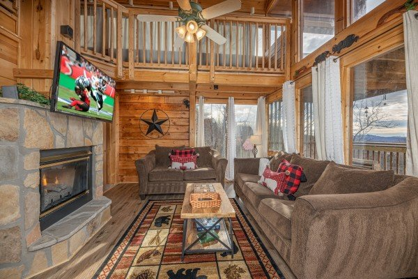 Sofa and loveseat in a living room at Smoky Mountain High, a 1 bedroom cabin rental located in Pigeon Forge