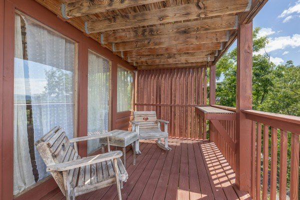 Seating on the lower deck at Smoky Mountain High, a 1 bedroom cabin rental located in Pigeon Forge