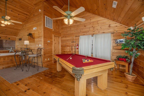 Red felt pool table at Smoky Mountain High, a 1 bedroom cabin rental located in Pigeon Forge