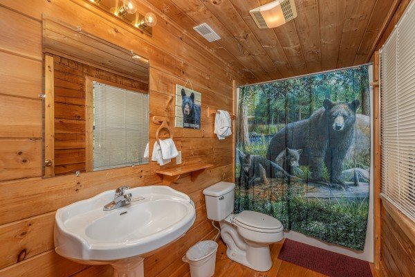 Bathroom with a tub and shower at Smoky Mountain High, a 1 bedroom cabin rental located in Pigeon Forge