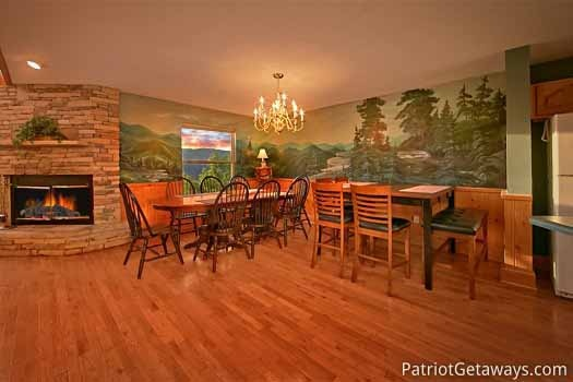 dining room area at night lights lodge a 7 bedroom cabin rental located in gatlinburg