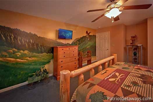 king size bedroom on main level at night lights lodge a 7 bedroom cabin rental located in gatlinburg