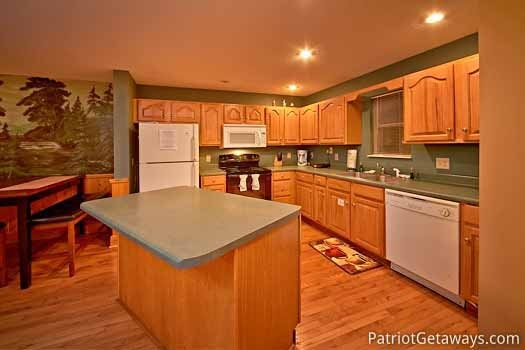 kitchen with island at night lights lodge a 7 bedroom cabin rental located in gatlinburg