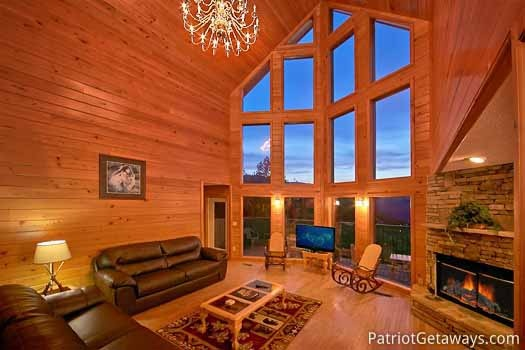 living room with cathedral ceilings at night lights lodge a 7 bedroom cabin rental located in gatlinburg