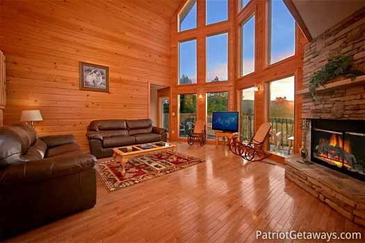 living room with sofa bed at night lights lodge a 7 bedroom cabin rental located in gatlinburg