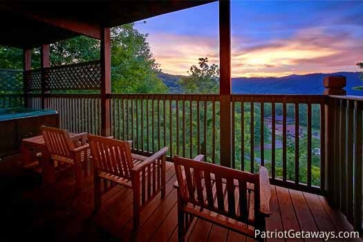 lower level deck sunset view at night lights lodge a 7 bedroom cabin rental located in gatlinburg