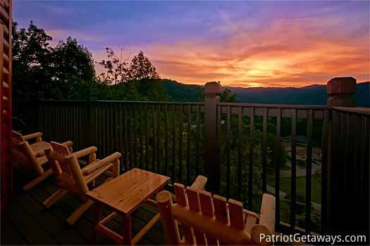 sunset over the smoky mountains at night lights lodge a 7 bedroom cabin rental located in gatlinburg