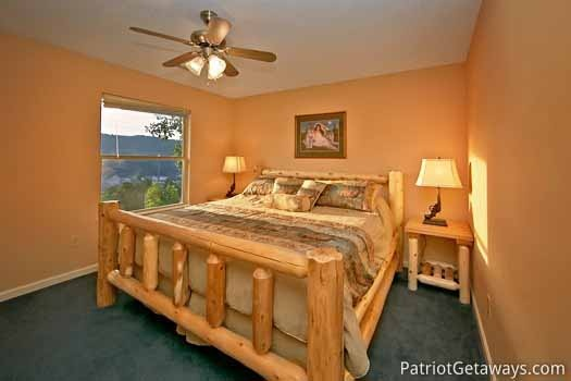 third floor king bedroom at night lights lodge a 7 bedroom cabin rental located in gatlinburg