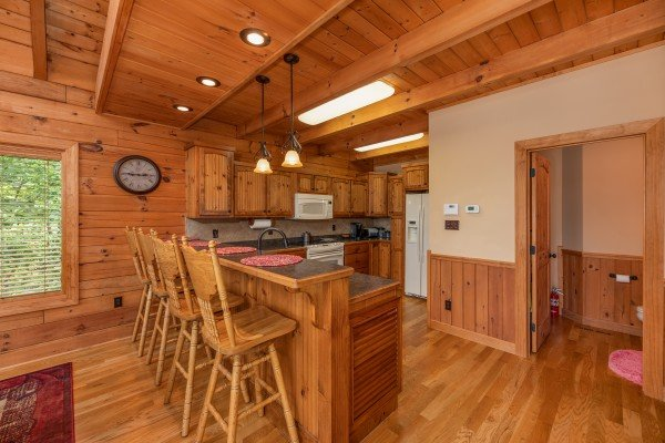 Breakfast bar with four chairs at Mountain Lake Getaway, a 3 bedroom cabin rental located at Douglas Lake