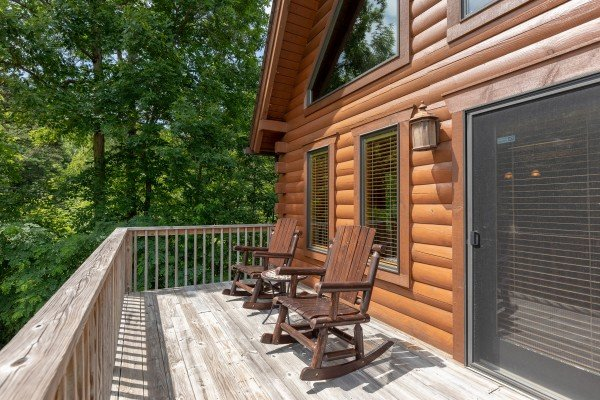 Rocking chairs on the open deck at Mountain Lake Getaway, a 3 bedroom cabin rental located at Douglas Lake