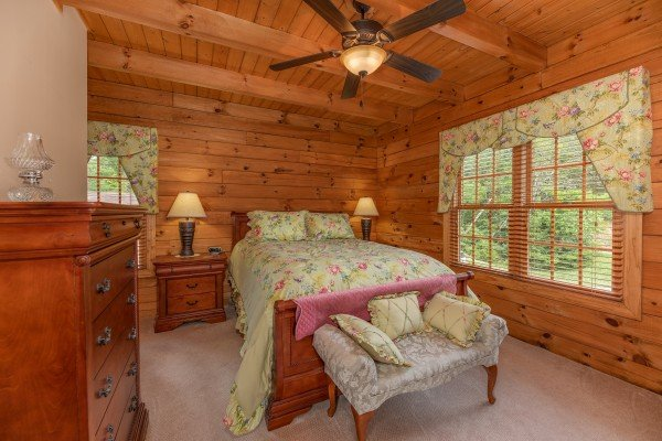 Bedroom with a bed, end tables, lamps, and a dresser at Mountain Lake Getaway, a 3 bedroom cabin rental located at Douglas Lake