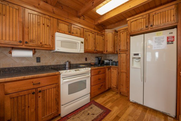 Kitchen with white appliances at Mountain Lake Getaway, a 3 bedroom cabin rental located at Douglas Lake