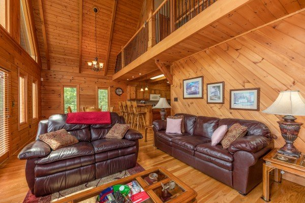 Sofa and loveseat in the living room at Mountain Lake Getaway, a 3 bedroom cabin rental located at Douglas Lake
