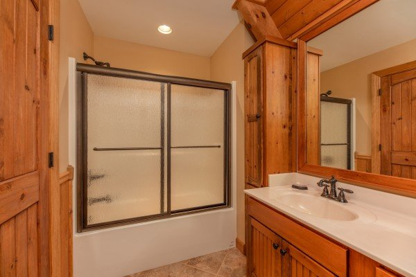 Bathroom with a tub and shower at Mountain Lake Getaway, a 3 bedroom cabin rental located at Douglas Lake